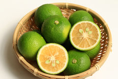 Kabosu on the colander. Citrus Cabos of Japan. Serve in bamboo basket Royalty Free Stock Photography