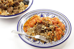 Kabsa bowl and meal horizontal. A traditional Saudi Arabian or Gulf Arab meat kabsa meal, of rice, onion, carrots, capsicum, spices, and beef, served with a Stock Image