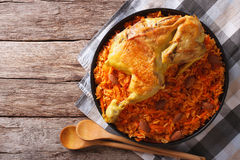 Kabsa of chicken with rice and vegetables on the table. Horizont. Kabsa of chicken with rice and vegetables on a plate on the table. horizontal view from above Stock Images