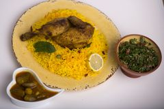 Kabsa middle eastrn food. Chicken kabsa with salat Royalty Free Stock Photos