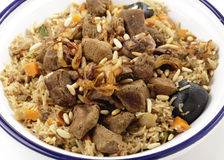 Kabsa serving bowl from above. Arab Gulf beef kabsa, also known as majbus, served in a Tunisian tagine bowl. Kabsa, a biryani-like speciality of the Gulf, is a Stock Photo