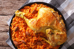 Kabsa - spicy rice with vegetables and chicken close-up. horizon. Kabsa - spicy rice with vegetables and chicken on a plate close-up. horizontal view from above Royalty Free Stock Photography