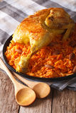 Kabsa - spicy rice with vegetables and chicken close-up. vertica. Kabsa - spicy rice with vegetables and chicken on a plate close-up. vertical Stock Image