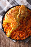 Kabsa - spicy rice with vegetables and chicken close-up. Vertica Stock Image