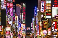 Kabuki-cho, Japan. TOKYO, Japan - DECEMBER 29, 2012: Billboards in Shinjuku's Kabuki-cho district. The area is a nightlife district known as Sleepless Town Stock Photo