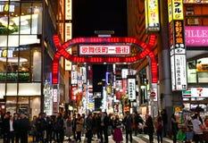 Kabukicho Ichibangai Gate and Crowds. Kabukicho Ichibangai of Kabukicho, Tokyo`s largest red-light and entertainment district stock photos