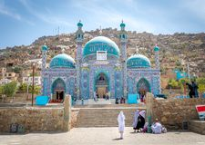Kabul mosque and young girl in Afghanistan stock images