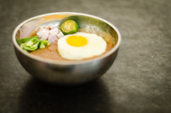 Kacang pool. Cooked pool nut with fried egg served to eat with bread royalty free stock images
