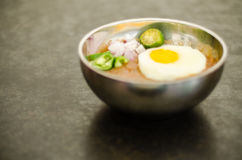 Kacang pool. Cooked pool nut with fried egg served to eat with bread Stock Images