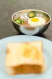 Kacang pool. Cooked pool nut with fried egg served to eat with bread Stock Image