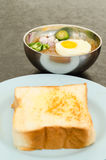 Kacang pool. Cooked pool nut with fried egg served to eat with bread Stock Photos