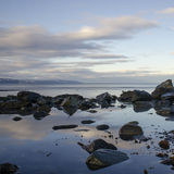 Kachemak Bay Shore 2. Clouds reflects in tidal pool Stock Images