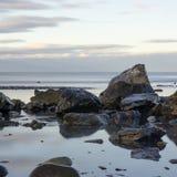 Kachemak Bay Shore 1. Rocks on the beach breakup the horizon line Royalty Free Stock Photos