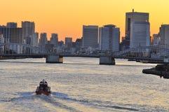 Kachidoki bridge in down town Tokyo , at sunset. The picture shows the famous Kachidoki bridge , located in Tokyo, Japan. Kachidoki Bashi (Bridge) crosses the Stock Photo
