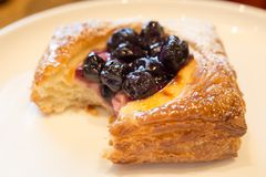 French boulangerie with custard and blueberries stock photos