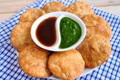 Kachori. With chutney indian snack stock images