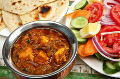 Kadai Paneer cheese curry. In a cardamon gravy, with naan bread and a side salad Royalty Free Stock Image