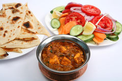 Kadai paneer curry. Kadai paneer cheese curry in a cardamon gravy, with naan bread and salad Stock Photos