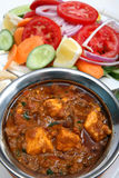 Kadai paneer curry. Kadai paneer cheese curry in a cardamon gravy, with naan bread and salad Royalty Free Stock Photo