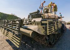 Young visitors of the exhibition inspect the main tank T-72B3M. KADAMOVSKIY TRAINING GROUND, ROSTOV REGION, RUSSIA, 26 AUGUST 2017: International military Royalty Free Stock Images