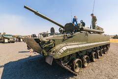 Young visitors inspect of the tank T-90A. KADAMOVSKIY TRAINING GROUND, ROSTOV REGION, RUSSIA, 26 AUGUST 2017: International military technical forum ARMY-2017 Stock Photography