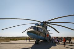 Transport universal military helicopter MI-26 and visitors of the exhibition. KADAMOVSKIY TRAINING GROUND, ROSTOV REGION, RUSSIA, 26 AUGUST 2018: Transport stock photos