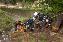 Kadan, Czech Republic, June 6, 2012: Exercise rescue units. Training rescue people in inaccessible terrain at the dam Kadan. Recov. Ery using rope techniques stock photo