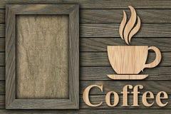 Kader en een kop van koffie op een houten achtergrond stock foto