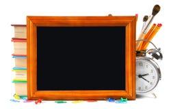 Kader en schoolhulpmiddelen Op witte achtergrond Stock Afbeelding
