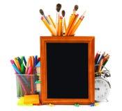 Kader en schoolhulpmiddelen Op witte achtergrond Stock Foto
