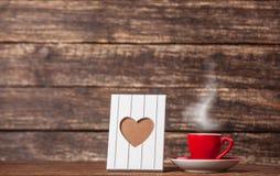 Kader met hartvorm en kop royalty-vrije stock foto