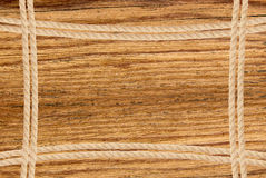 Kader uit kabel over houten achtergrond wordt samengesteld die Stock Fotografie
