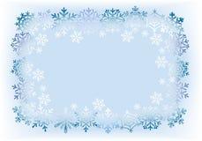 Kader van sneeuwvlokken op lichtblauwe achtergrond. Stock Fotografie