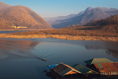 Kaeng Kor is big lake which surrounded by mountains with housebo Stock Photography