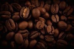 kaffe för closeup för astractbakgrundsbönor Arkivfoto