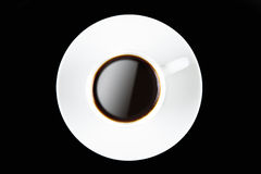 Kaffe kuper på svart Arkivbild