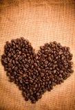 Kaffe kärnar ur ramen Arkivbild