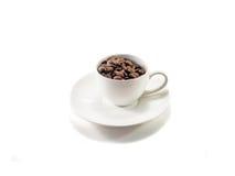 Kaffe kuper och kaffebönor Royaltyfri Bild