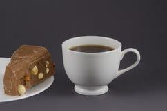 Kaffe kuper och mjölkar choklad Arkivfoto