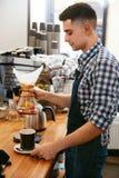 Kaffe Mandanandedrink i kafé arkivfoto