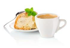 Kaffe med äpplekexet och ett blad av mintkaramellen Arkivbilder