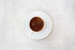 Kaffe med en smileyframsida på den Arkivfoton