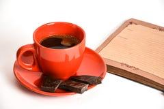 Kaffe och anteckningsbok Royaltyfri Bild