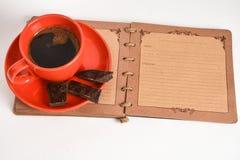 Kaffe och anteckningsbok Arkivbild