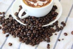 Kaffe och böna Arkivfoto