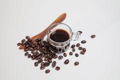 Kaffe och bönor Arkivfoto