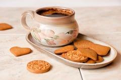 Kaffe och kakor Arkivfoto