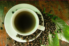 Kaffe och kakor i morgonen arkivfoton