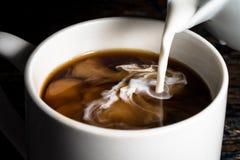 Kaffe och kräm Arkivfoton