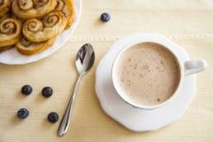 Kaffe och palmiers Arkivfoto